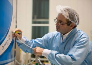 Christophe Bardou, Arianespace's DIRECTV-14 Program Director, puts his signature on the Ariane 5 payload fairing.