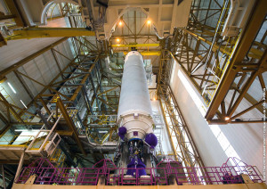 The cryogenic core stage for Flight VA225's Ariane 5 is shown suspended over its mobile launch table in the Spaceport's Launcher Integration Building.