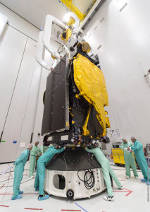 The EUTELSAT 8 West B satellite makes contact with the cone-shaped adapter that will be used in its integration on the workhorse Ariane 5 vehicle. This activity occurred in the Spaceport's S5 payload preparation facility.