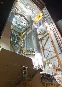 Installed on its mobile launch table, the Flight VA216 launcher is ready to roll out from the Spaceport's Ariane 5 Final Assembly Building for its early morning transfer to the ELA-3 launch zone.