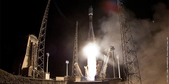 Powered by its first and second stages, Arianespace's Flight VS06 Soyuz climbs away from the Spaceport in this wide-angle image.