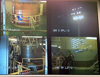 The Jupiter Mission Control center's split-screen display provides camera views of the Soyuz launch site in French Guiana, including close-ups of the vehicle's stages and payload fairing.