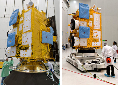 INSAT-3D undergoes its fit-check with the cone-shaped device that will serve the satellite's interface with Ariane 5 (photo at left).  This activity occurred in the Spaceport S5 payload preparation center's S5C processing hall, and was followed by INSAT-3D's internal transfer to the S5B zone for fueling (at right).