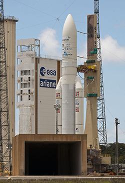 The Ariane 5 with Alphasat and INSAT-3D nears its final location on the launch pad to complete this morning's rollout at the Spaceport.