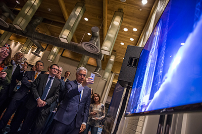 Ariane 5's liftoff with EUTELSAT 65 West A is viewed by invited guests during an early morning reception organized by Arianespace at the Satellite 2016 convention.