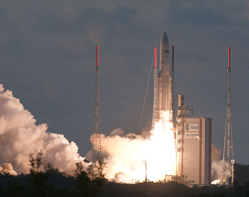 During its on-time liftoff today, Ariane 5 ascends from French Guiana at sunset with the EchoStar XVII and MSG-3 satellite payloads.