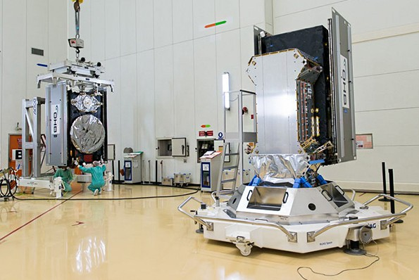 The Galileo FOC Flight Model 6 satellite – one of the two Galileo co-passengers Arianespace's upcoming Soyuz mission – is shown during its transfer inside the Spaceport's S3B clean room facility for integration on the dispenser system. At right is the dispenser, with the already-installed FOC Flight Model 5 spacecraft.